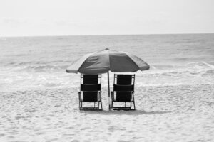 beach umbrella and two chairs on the beach